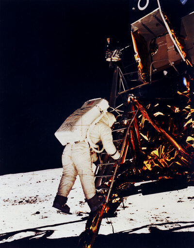 NASA photo of Buzz Aldrin stepping off of the LM ladder